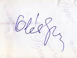 Oláh György aláírása a fenti kép hátoldalán
